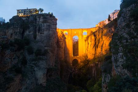 ronda: Ancient stone bridge  in twilight. Ronda, Stock Photo