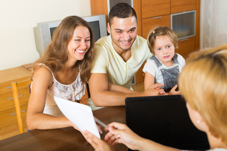 russian parents with daughter glad hearing words of social worker at  home