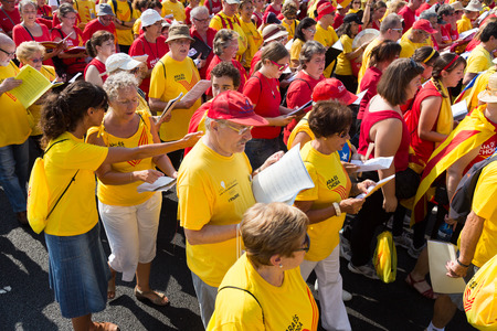 demanding: BARCELONA, SPAIN - SEPTEMBER 11, 2014: People  singing at rally demanding independence for Catalonia in Barcelona