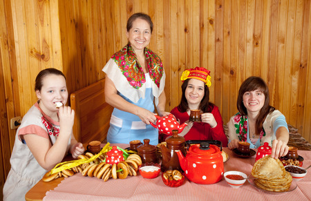 banket: Women drinking tea with russian traditional snack Stock Photo