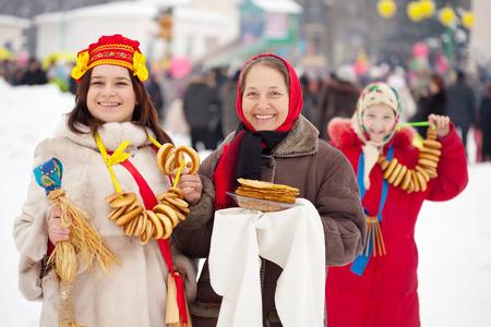 maslenitsa: happy women celebrating  Maslenitsa festival at Russia Stock Photo