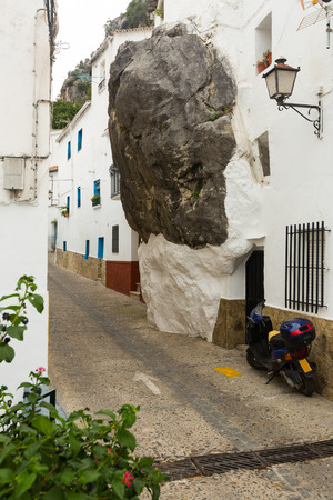 dwelling house: Dwelling  house built with rock inside in spanish town. Ubrique