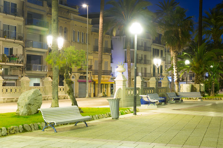 vacationers: Pavement embankment in  night. Place for walking residents and vacationers. Sitges, Spain