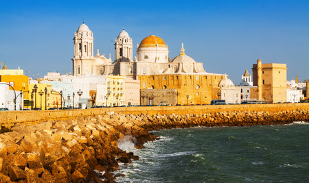 Sunny view of  Cathedral and  ocean coast. Cadiz Stock Photo