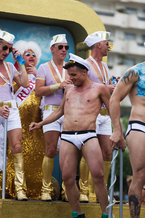 flatfoot: SITGES, SPAIN - JUNE 15, 2014: People dressed as seamen at procession of Gay pride parade in Sitges Editorial