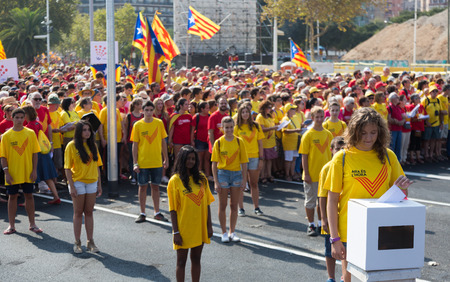 independency: BARCELONA, SPAIN - SEPTEMBER 11, 2014: Young girls at rally demanding independence for Catalonia in Barcelona