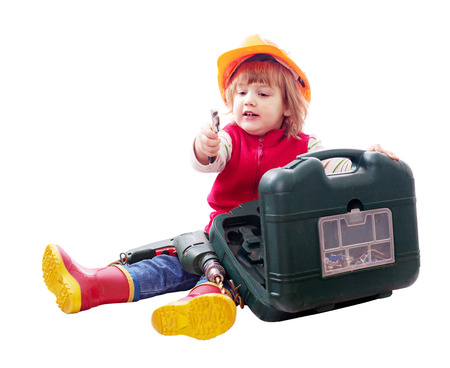 hardhat: Sitting child in hardhat with tools. Isolated over white Stock Photo