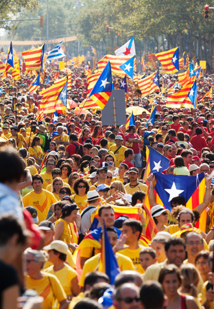 demanding: BARCELONA, SPAIN - SEPTEMBER 11, 2014: People at rally demanding independence for Catalonia (National Day of Catalonia). Barcelona