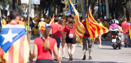 independency: BARCELONA, SPAIN - SEPTEMBER 11, 2014: People converge on Barcelona to join a rally demanding independence for Catalonia