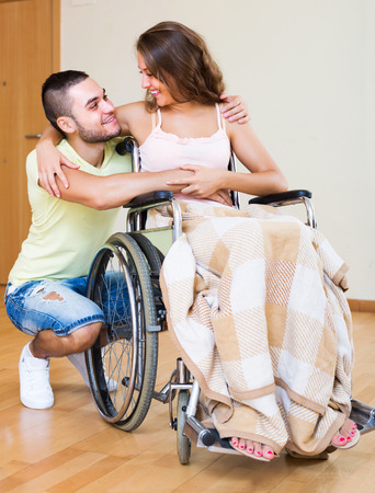 spouse: Portrait of happy couple with disabled spouse in love Stock Photo