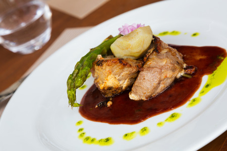 recipe decorated: Grilled Lamb Cutlets with sauce and vegetables at restaurant Stock Photo