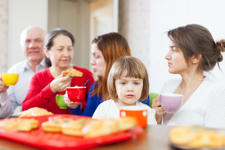 cooky: Portrait of multigeneration family having breakfast at home together