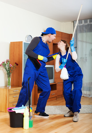 impish: Smiling cleaning premises team is ready to work Stock Photo