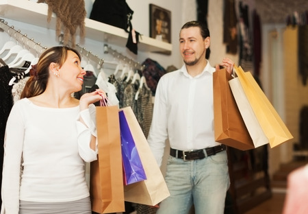 gladful: Happy houple with shop-bags at clothing store