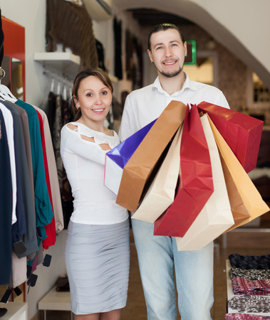 couple  with shopping bags at clothing store photo
