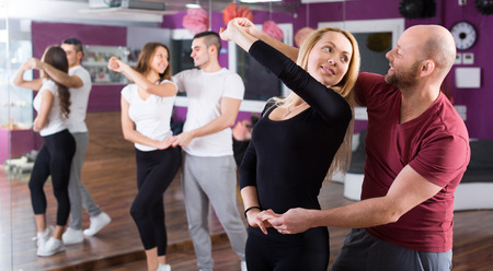 Happy young people having pasodoble dancing class indoors Stock Photo