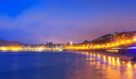 autonomous: View of La Concha beach in evening at Donistia. Basque Autonomous Community, Spain Stock Photo
