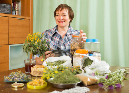 medicinal herbs: elderly woman with medicinal herbs Stock Photo