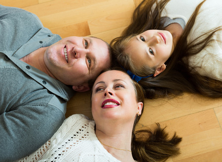 convection: Portrait of mother,smiling father and cute girl together indoors Stock Photo