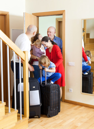 come home: Family seeing off the relatives to vacations Stock Photo