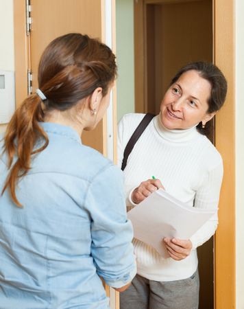woman answers the questions in door at home