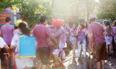 vino: HARO, SPAIN - JUNE 29, 2014: Wet people during Haro Wine Festival (Batalla del vino). People pour wine at each other  from botas, bottles and buckets during festival Batalia de Vino Editorial