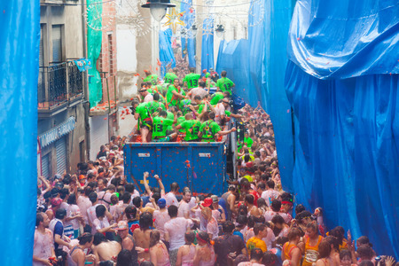 BUNOL, SPAIN - AUGUST 28: Battle of tomatoes - tomatoes madness  in August 28, 2013 in Bunol, Spain. La Tomatina festival where people throw tomatoes Editorial