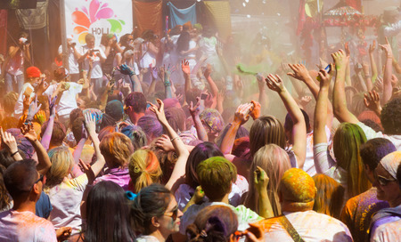 colores: BARCELONA, SPAIN - APRIL 6, 2014: Crowd at IV Festival de los colores Holi Barcelona. Holi is traditional holiday of India