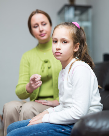 room to let: Woman scolding daughter at home interior