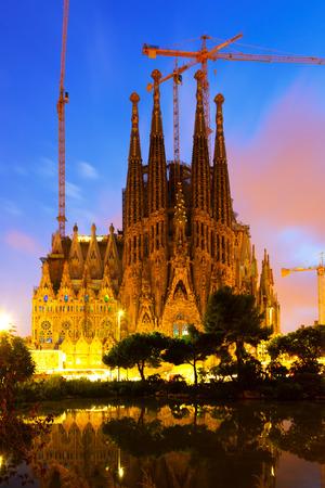 begun: BARCELONA, SPAIN - SEPTEMBER 13, 2014: Sagrada Familia in evening. Barcelona, Spain.  Famous Church building is begun in 1882