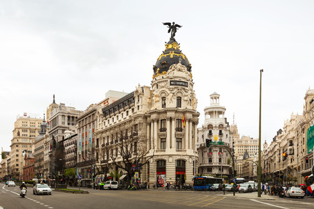gran via: MADRID, SPAIN - APRIL 26: Crossing the Calle de Alcala and Gran Via in April 26, 2013 in Madrid, Spain. It is most important avenues at city