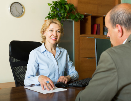 make public: Public notary helping senior client to make a will