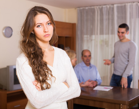 hypothec: Sad girl faced with misunderstanding big european family