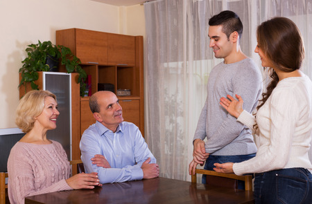 affiance: happy parents meeting girlfriend of their son at home