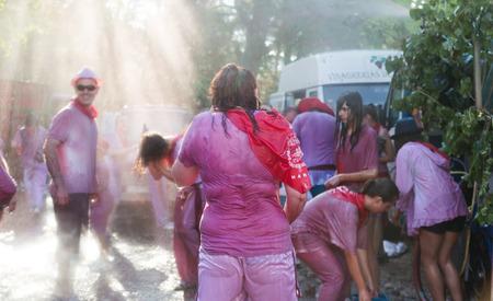 vino: HARO, SPAIN - JUNE 29, 2014: Happy people during Batalla del vino - wine madness in Haro. People fighting with wine Editorial