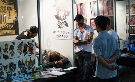 17th: BARCELONA, SPAIN - OCTOBER 3, 2014: People at the 17th edition of The Barcelona Tattoo Expo in Fira de Barcelona