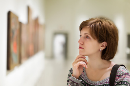 museums: Girl looking pictures in  gallery
