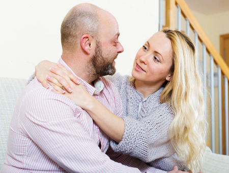 gladful: Happy loving  couple in home. Focus on girl Stock Photo