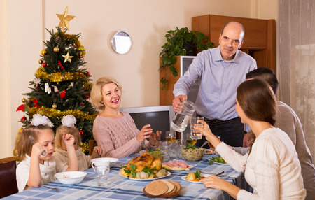 bosom: Celebration of christmas in the bosom of happy family at the table at home