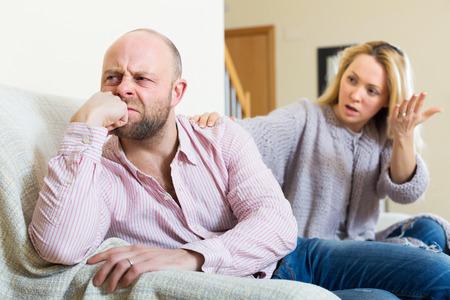 Casual family having quarrel in livingroom Stock Photo