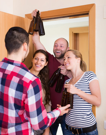 booze: Happy adult friends gathering together at house booze party Stock Photo