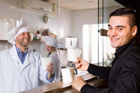 house robes: Portrait of happy customer, professional chefs at fastfood place