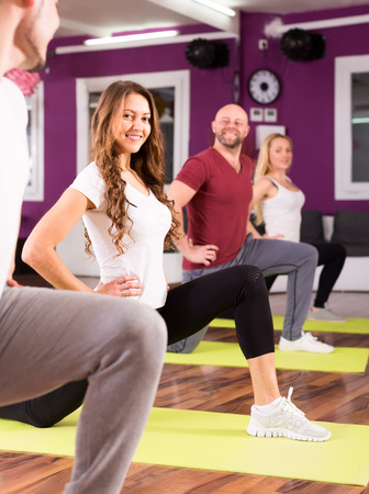 plasticity: Active people training on mates at fitness school