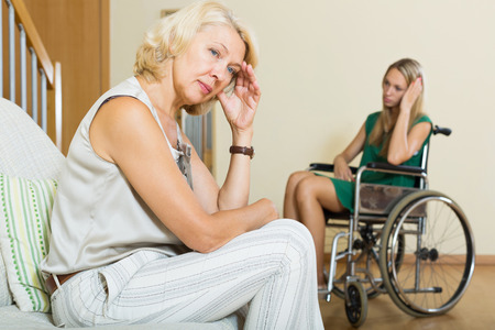 relative: Communication problems between girl in wheelchair and female relative