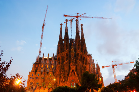 uncomplete: BARCELONA, SPAIN - SEPTEMBER 13, 2014: Sagrada Familia in evening. Barcelona. Basilica and Expiatory Church of Holy Family by Gaudi, building is begun in 1882 and completion is planned in 2030 Editorial