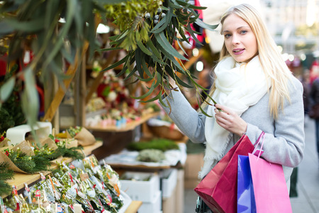 good looking woman: Beautiful good looking woman choosing eucalyptus at a Christmas market