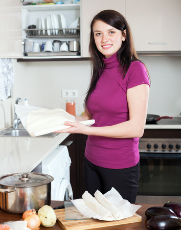 prepack: girl cooking with store-bought dough at home Stock Photo