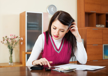 parsimony: woman thinking about the financial issue at  home
