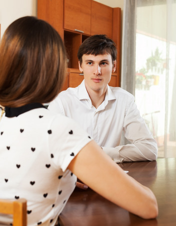 outreach: Woman answer questions of outreach worker with paper at office
