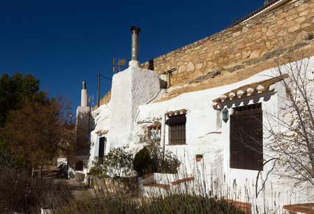 aves: Dwellings  aves built  into mount.  Chinchilla de Monte-Aragon, province of Albacete, Spain Editorial